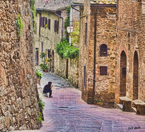 Boy on an empty street , San Gimignano