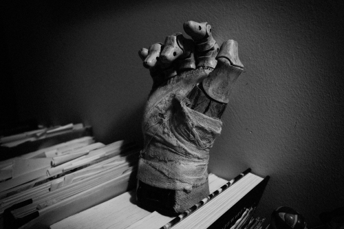 garnithe hand o'er the books